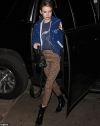 Emma Roberts looks effortlessly chic as she styles a cord jacket with leopard