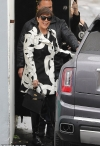 Kris Jenner sports chic black and white coat while dodging the rain in LA... as it's revealed youngest daughter