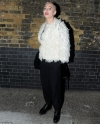 Rose McGowan looks fashionable in a feathered jacket after sharing