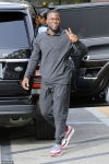 Kevin Hart flashes a smile and peace sign during family lunch with wife and kids...
