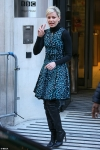 Elizabeth Banks looks chic in a blue leopard print dress as she joins Chris