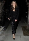 Elizabeth Hurley, 53, flashes her cleavage in a low-cut top as she enjoys