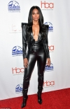 Ciara puts her midriff and ample assets on display in skin-tight black leather