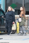 Ariana Grande adds to her 5feet frame as she steps out in platform Nike