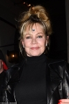 Melanie Griffith accessorises her look with quirky silver heart sticker