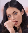 Megan Fox flashes her very toned legs as she SKIPS trousers while in nothing but a long blazer...