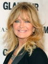 Goldie Hawn looks just as toned at 75 while trimming her Christmas tree