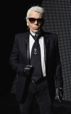 Karl Lagerfeld, 85, displays missing teeth as he flashes a broad grin